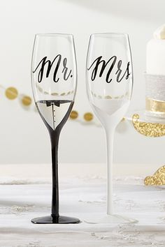 These Tuxedo and Wedding Gown Mr. & Mrs. Toasting Flutes feature a lovely black and white color scheme that is sure to impress guests. | Tuxedo and Wedding Gown Mr. & Mrs. Toasting Flutes | My Wedding Favors