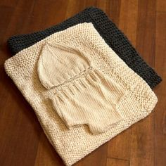 """Organic Cotton Layette SetThe perfect gift for a newborn with soft, chunky knit blanket- 24"""" by 24"""", nappy cover and hat. Wonderful for newborn babies and useful beyond! Available in Natural and charcoal grey- a lovely unisex shower present!"""