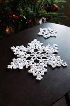 100 Crocheted Snowflake Patterns - I discovered this amazing directory of snowflake patterns linked from a fantastic blog called Snowcatcher. I seriously recommend checking this out. This woman has mad snowflake-making skills. There are over 100 snowflake patterns on that directory and they are all unique.