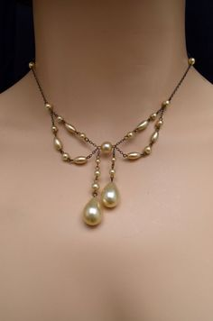 flip the pearl so the loops and top to bottom and not side to side, hang single dangle