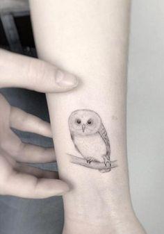 Delicate Owl Tattoo on Wrist by Jakub Nowicz