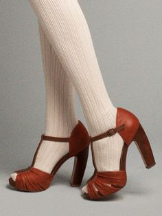 Wearing stockings with peep toed heals. This is a risky move, but it's adorable if done right. Perfect for fall!