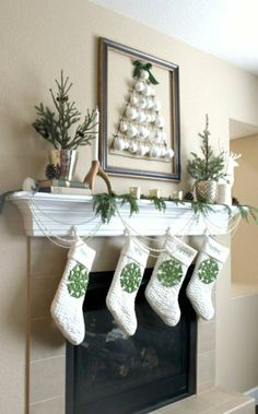 The Sweet Survival: 2012 Holiday Mantel. Pottery Barn stockings and cheap added snowflakes.