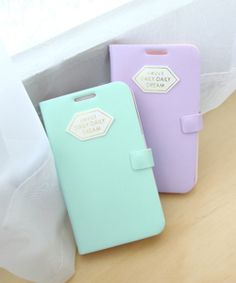 Happymori Pastel Logo Patch Leather Flip CoverHappyMori specializes in quality cell phone cases designed at the design studio in South Korea. You