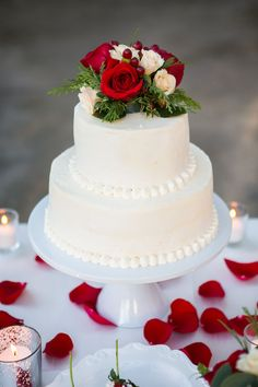 Ivory Beaded Wedding Cake with Roses The two-tiered wedding cake was beaded at the bottom of each tier and topped with ivory and red roses. The cake was positioned on a white stand surrounded by red rose petals and lit candles. Beaded Wedding Cake, 2 Tier Wedding Cakes, Red Rose Wedding, Fondant Wedding Cakes, Black Wedding Cakes, Cool Wedding Cakes, Elegant Wedding Cakes, Wedding Cake Designs, Fondant Cakes