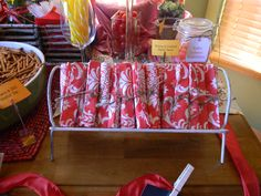 Napkins rolled up and tied with jute string display on a little white, metal stand.