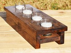 This is a lovely wooden votive candle holder that would be perfect as a table centerpiece or on a fireplace mantle. Five votive candles in glass holders are included. It is made from solid wood using pocket hole joinery. The holder has a shelf inside to support the candles. Replacement candles are readily available at hobby or big box stores. The pictured stain is Special Walnut. If another stain or color is desired, please message me.
