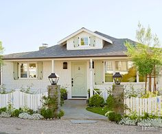 Little design details add up to big style in a small front yard. Here, a charming fence and swath of plantings boost interest and curb appeal. A flagstone path leads right up to the entrance, while a small dormer displays welcoming presence.      /