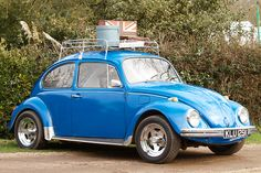 VW Beetle - mine was blue too - with the fancy mags. loved it!