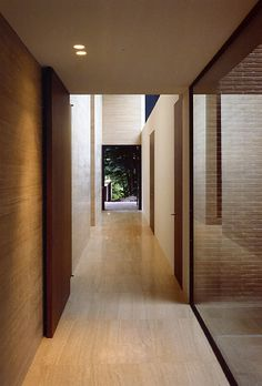 View of the corridor inside the VDV-G house by Belgian architect Vincent van Duysen. Beautiful traverine stone.