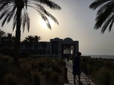 The dusky sun warms our crew as they capture the hotel The Chedi Muscat, Zen Style, Leading Hotels, Palm Trees, Paradise, Sunset, Architecture, Luxury, World