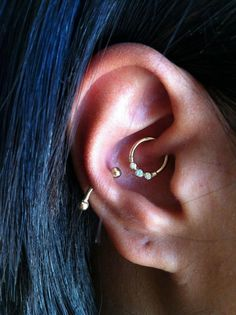 strangecityedmonton:  today we got to spruce up this healed daith piercing by putting a yellow gold 'Faraway' ring from BVLA in it. so pretty!