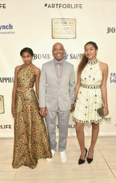 Russell Simmons attends his Art for Life fundraiser with daughters Aoki Lee and Ming Lee.