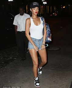 You can't make them longer! Rihanna was seen tugging at the denims as she was photographed arriving back at her hotel after a night out