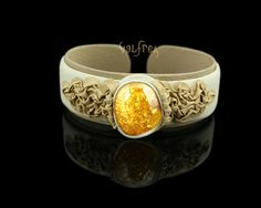 Scandinavian Royal Jewellery. White Leather with yellofw sparling Amber. This adjustable bracelet will create a unique atmosphere around you.  Stand out of the crowd, be yourself. #leather #jewellery #amber #handmade #bracelet #bangle #unique #fashion #unisex #leatherjewelry #oneofakind at valfrea.com.au