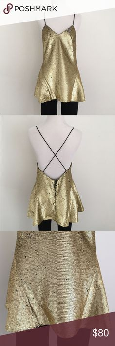 NWT gold sequin peplum tunic w spaghetti straps NEW WITH TAGS! Gold sequin tunic-length peplum top with black spaghetti straps, v-neck, and low back. Zip closure at back. Never worn. Gorgeous top! By Finders Keepers. Finders Keepers Tops