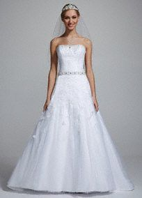 Timeless beauty combined with ethereal elegance makes this dress a true one of a kind masterpiece! Strapless bodice features all over beaded detail and eye-catching sparkling jeweled belt. Beaded floral full tulle skirt adds a touch of romantic and drama. White available online. Fully lined. Back zip. Imported polyester. Dry clean.A popular neckline for brides seeking a stylish and versatile look (offering unlimited jewelry and accessory options).A sheer to semi-sheer net fabric often used…