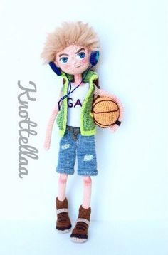 Amigurumi doll wearing headphones and with a basket ball. ♡