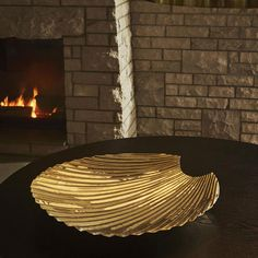 Decoration just got dramatic with this Concha dish from AYTM. In shining brass, it's in an elegant shell shape which will look glamorous on a coffee table or dressing table. Fill it with trinkets or leave it empty to let the detailed design shine through. Home Comforts, Decorative Bowls, Coffee Mugs, Shells, Table Lamp, Dishes, Elegant, Outdoor Decor, Gold