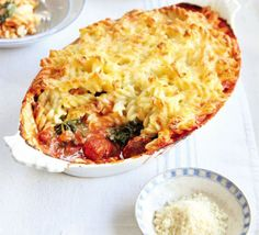 sausage ragu and spinach pasta bake.  2 ways- one for meat lovers and one for their vegan lovers.