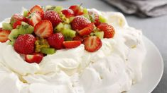 Strawberry and kiwi pavlova Make your very own strawberry and kiwi pavlova and impress your friends and family with this recipe. Bake your meringue the day before and then to serve top with whipped double cream, strawberries and Strawberry Kiwi, Strawberry Recipes, Gourmet Recipes, Dessert Recipes, Healthy Desserts, Greek Baklava, Traditional Christmas Food, Meringue Desserts, Recipes