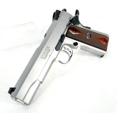"Ruger SR1911 Stainless .45 ACP 5"" *NIB*. Model 6700. Features include original 1911 Series 70 design for easy takedown and re-assembly; stainless steel barrel and bushing; lightweight, aluminum, skeletonized trigger & skeletonized hammer; dovetailed, 3-dot sight system with Novak LoMount Carry rear sight; oversized beavertail grip safety and extended thumb safety. Low glare stainless steel finish. 8+1 capacity of .45ACP. 5"" barrel. 39 oz. $699.99"