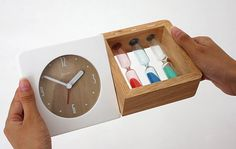 Using a concealed magnetic connector, the two-in-one timepiece breaks with tradition by uniting three old-fashioned sandglasses with a modern alarm clock. With red, blue, and green hourglasses that last for one, three, and five minutes.