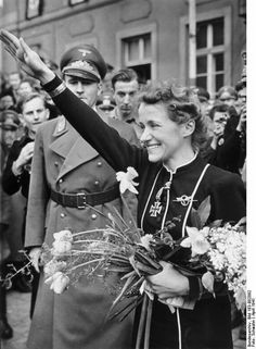 Luftwaffe Flugkapitän Hanna Reitsch visiting her home town of Hirschberg, Germany; c. spring of 1941.