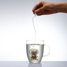 Tea Diver by Yoon Sung-Mun and Kim Sun-Young, yankodesign: Inspired by the Korean traditional diver, Meoguri, which only relies on a line linked to an oxygen tank to explore the deep sea. Made of silicone #Tea_Infuser #Tea_Diver #Yoon_Sung_Mun #Kim Sun_Young #yankodesign
