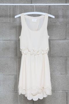 A good little white summer dress. Love the scalloped edge.