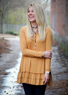 Everyone needs a little glow - that's why this Golden Glow Ruffle Top is such a great piece! This top is ideal for flaunting your favorite statement necklaces or scarves. You can dress it up or down a