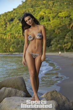 Emily Ratajkowski Swimsuit Body Paint - Sports Illustrated Swimsuit 2014 - SI.com Photographed by Walter Iooss Jr. in St. Lucia. Swimsuit inspired by Susan Holmes Swimwear from the 2007 Susan Holmes Swimwear suit.