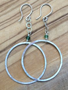 Hand Forged Sterling Hoops with a beautiful Emerald of Elegance!