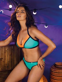 Bondi embraces sports luxe styling with bold, block colours in shades of vibrant papaya and sea spray green. The soft triangle bikini tops offers a comfortable and on-trend style with soft padding in the cups for great shape and support.
