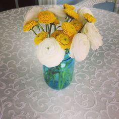 kitchen themed bridal shower - table decor fresh flowers in blue mason jars!