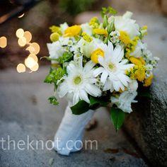 A blog photo inspired Brandi's bouquet of yellow and white gerbera daisies, ranunculus, white Montecasino and craspedia.