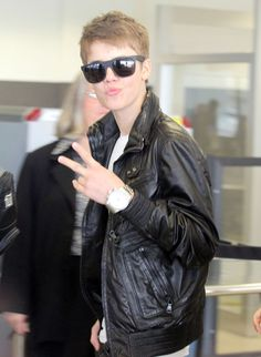 Justin giving his fans, the peace sign!  #Justin