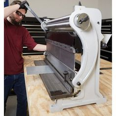 This Klutch® Combination Sheet Metal Machine is a versatile combo unit that allows you to cut, bend and shape metal. Sheet Metal Tools, Metal Bending Tools, Metal Working Tools, Metal Working Machines, Sheet Metal Work, Sheet Metal Bender, Metal Fabrication Tools, English Wheel, Metal Shaping