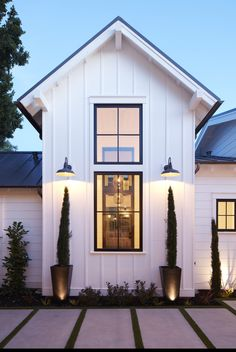 White board and batten siding and black window frames with thin mullions - elements to create a classic farmhouse style with a modern twist. Informations About White board and batten siding and black