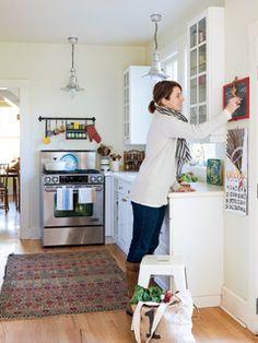 A small, white kitchen