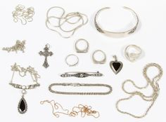 """Lot 522: Sterling Silver Jewelry Assortment; Including six necklaces with one having an attached pendant and one having a gold vermeil finish, three bracelets with one cuff by Reed & Barton in the """"Florentine Lace"""" pattern, four rings with two signet rings by Jewel Arts and one spoon ring by Alvin in the """"Bridal Bouquet"""" pattern, two pendants and a bar pin having crystals; all marked"""
