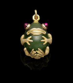 a jeweled gold-mounted nephrite miniature egg pendantFabergé, Moscow, 1899-1908