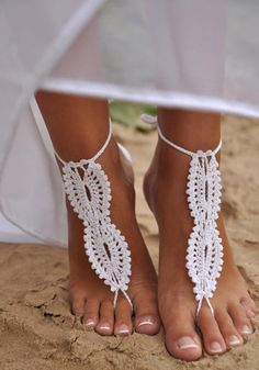Front view of model in white barefoot sandals