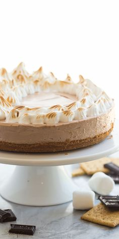 This No Bake S'mores Cheesecake is one of THE BEST cheesecakes I've ever made! A smooth chocolate marshmallow cheesecake on a graham cracker crust, topped with toasted homemade marshmallow cream! www.thereciperebel.com