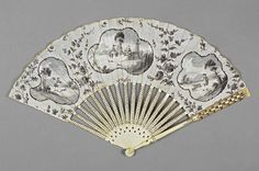 Date: circa 1780 — circa 1785  Period: 3rd quarter 18th Century  Description: The double-paper leaf is painted 'en grisaille' in bodycolour; on the reverse is painted a grey spray of flowers. The sticks and guards are of ivory, shaped, painted and carved on the guards. This fan may have been used for 'half-mourning'.  Dimension(s): length, guards, 27.4, cm width