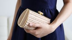 Nude clutches are so practical and this one happens to be so quaint too
