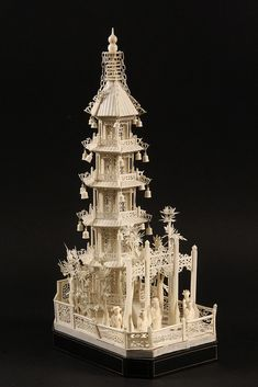 "CHINESE IVORY PAGODA MODEL UNDER GLASS DOME - Extremely Detailed 19th c Model of a Five Gallery Pagoda Tower with finely reticulated panels, chains suspended from peak, bells from the point of each eave, surrounded by a fenced bamboo garden, formal gate in foreground with four women flanking a priest. The ivory alone is 16 3/4"" x 8 1/4"" x 6 1/4"", the cover is 19"" x 9"" x 10 1/2"""