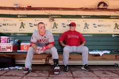 Los Angeles Angels Mike Trout (OF) and Mike Scioscia (Mgr) sitting in the dugout before a game in Oakland Coliseum