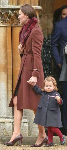 Kate and charlotte leaving church after christmas morning service