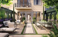 """A garden courtyard off the building's ground floor. """"We wanted you to feel as though you are in a boutique museum in Europe,"""" Pinto says of the details and materials used."""